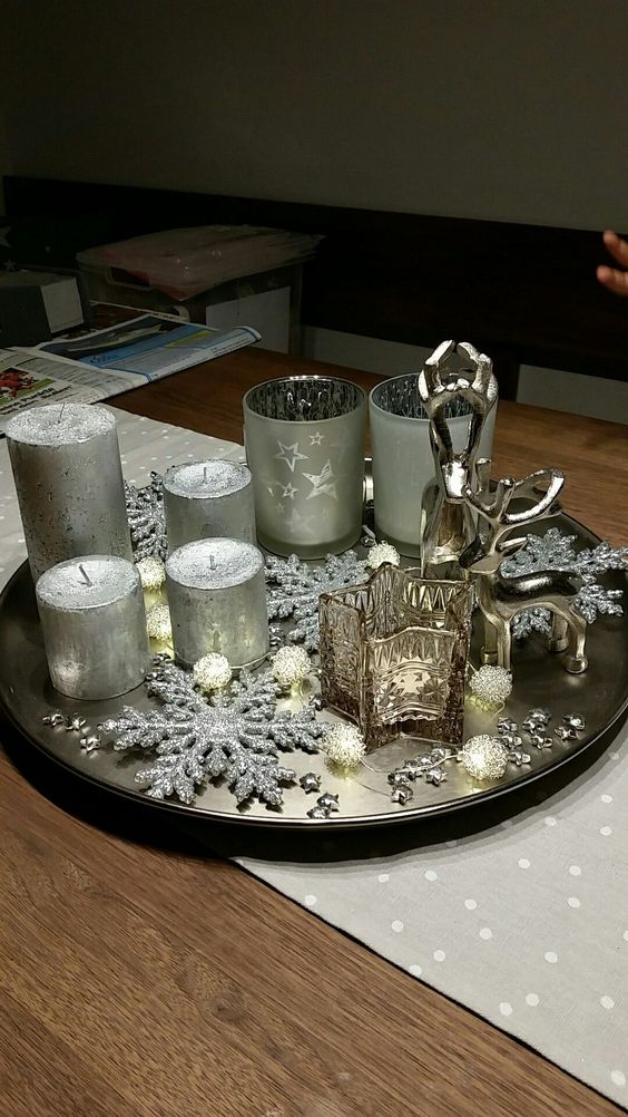 Christmas arrangement with a plate or tray with candles